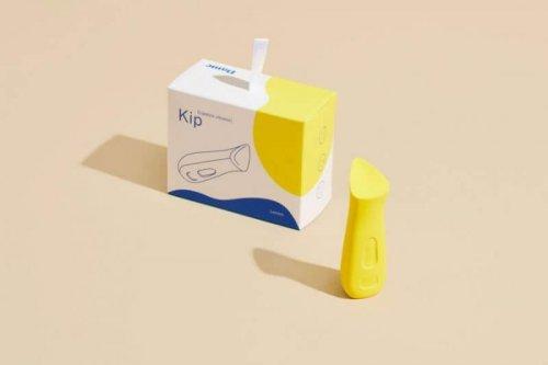 The Kip Vibe box sitting beside the Kip in Lemon.
