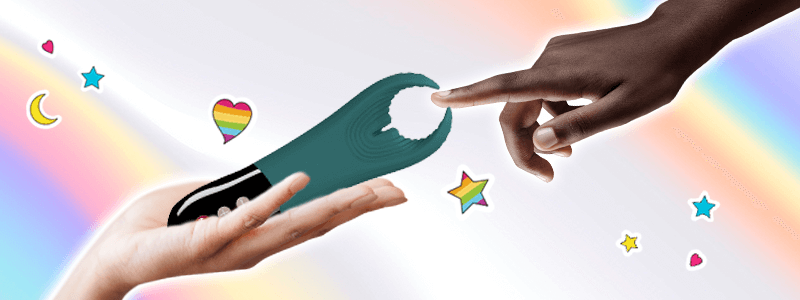 One person holds the Manta by Fun Factory out to a second person, who extends a finger to touch the tips. Behind their hands is a rainbow background and the image is accented by rainboe hearts and stars.